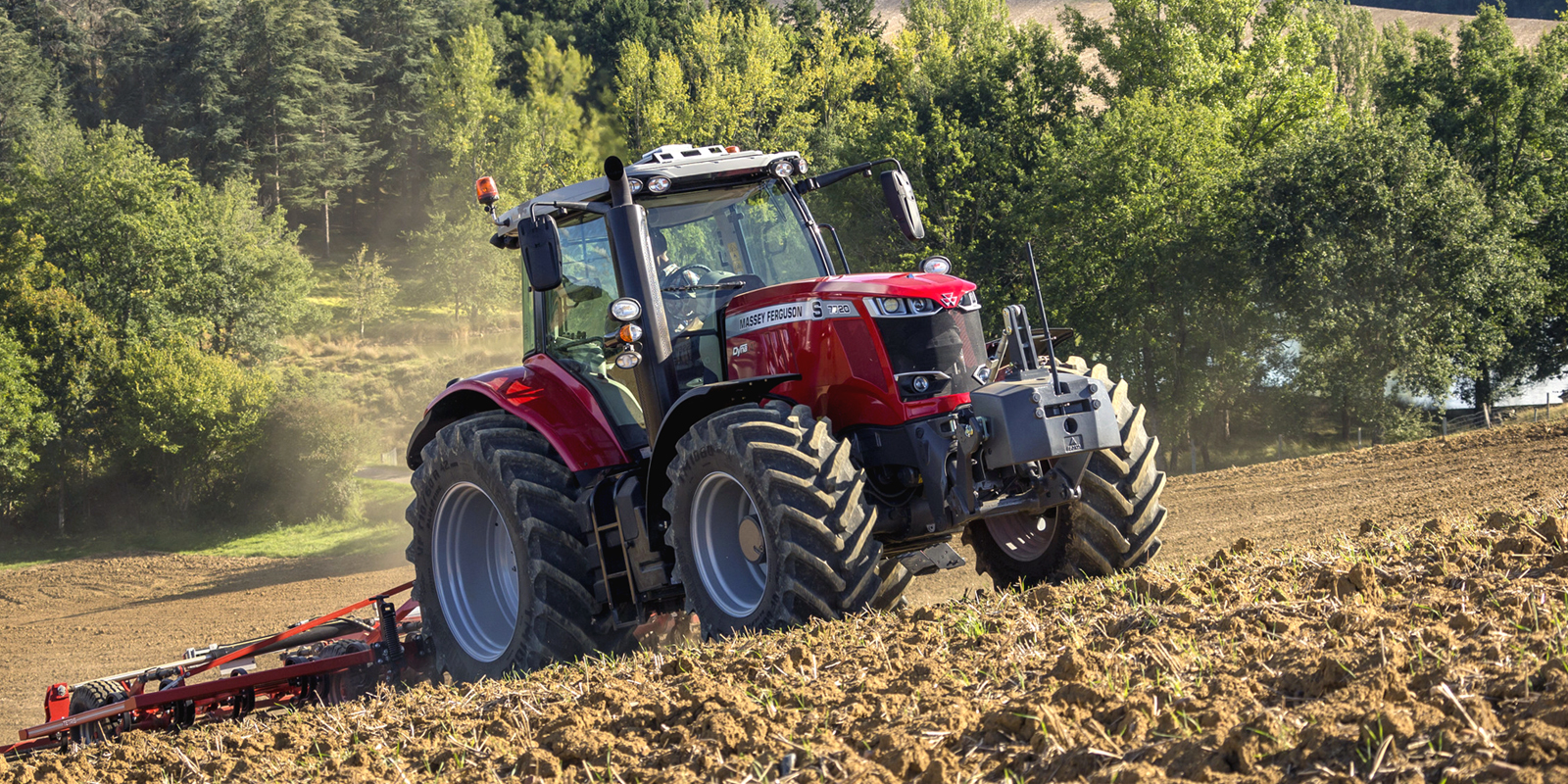 massey ferguson 7700s series tractor tilling land
